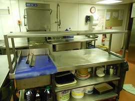 Stainless steel sit-on gantry for extra working space